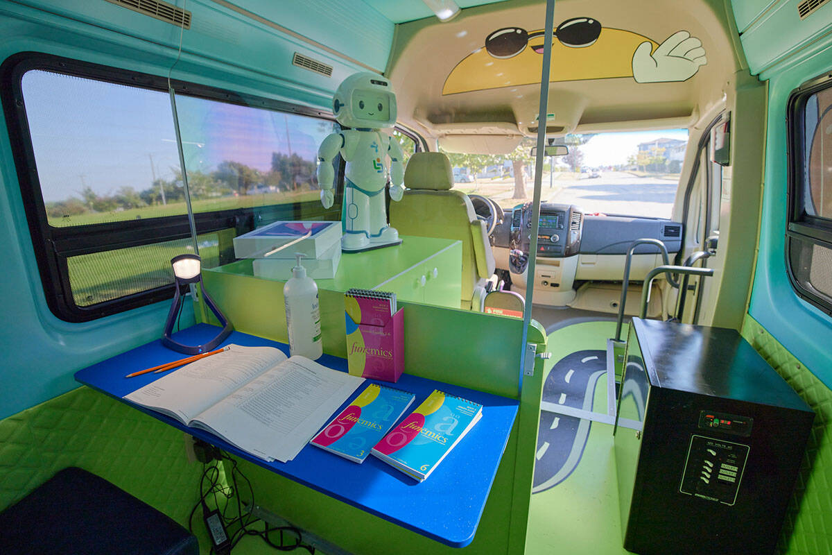 The inside of the LDS Access bus is complete with custom-built learning stations, engaging interior designs and a learning assistant robot named QT. (LDS photo)